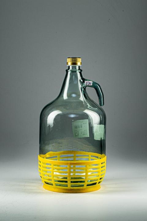 Бутыль Dama 5 лит. в корзине с завинчивающей пробкой